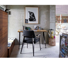 Prouve Fauteuil Direction Chair Black with Compas Direction Desk in Room Vitra