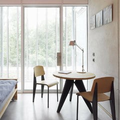 Prouve Small Gueridon Table in room with Standard Chairs and Artemide Tolomeo Table Lamp Vitra