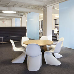 Prouve Gueridon Table in Office with white Panton Chairs Vitra