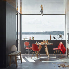 Prouve Gueridon Table in room with Eames Chairs by Window to Lake Como Vitra
