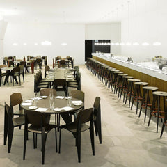 Prouve Tabouret Haut Bar Stools in Office Cafe with Standard Chairs and Gueridon Tables Vitra