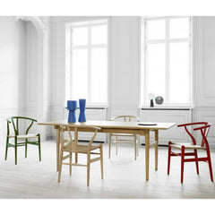 Wegner Wishbone Chairs in Red Green and Oak in room with Wegner Dining Table