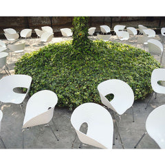T-Vac chairs outdoors around tree Ron Arad for Vitra
