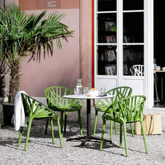 Ronan and Erwan Bouroullec's Belleville Outdoor Round Bistro Table with Vegetal Chairs by Vitra