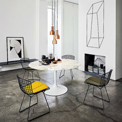 Marble Saarinen Dining Table in room with Black Bertoia Chairs Knoll
