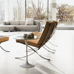 Saarinen Side Table in room with Barcelona Chairs and Barber Osgerby Sofa