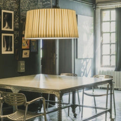 Santa Cole GT7 Suspension Lamp in room with Toledo Chairs