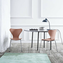 Series 7 Chairs Chocolate Milk in Room with Green Rug Fritz Hansen