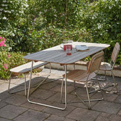 Skagerak Lilium DIning Table and Chairs with Punch and Flowers