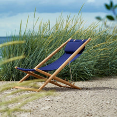 Skargaarden H55 Sun Lounger on Beach Navy Blue Sunbrella and Teak