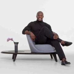 Terry Crews sitting on the Lilypad he designed for Bernhardt Design