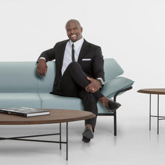 Terry Crews with the Float Tables and Ibis Sofa he created for Bernhardt Design