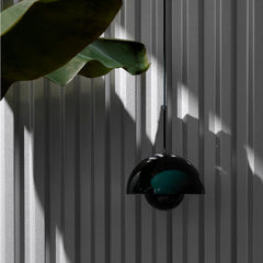 Verner Panton VP1 Flowerpot Pendant Dark Green in studio with plant And Tradition Copenhagen