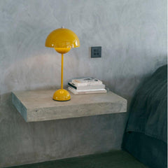 Verner Panton VP3 Flowerpot Lamp in Mustard Yellow Styled on Concrete Shelf And Tradition Copenhagen