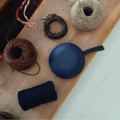Vifa Reykjavik Speaker Ice Cave Blue on shelf with Yarn