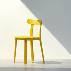 Vitra All Plastic Chair Buttercup Yellow by Jasper Morrison in Sunlight
