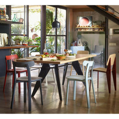 Vitra All Plastic Chairs by Jasper Morrison in room with Prouvé EM Table and Standard Chair