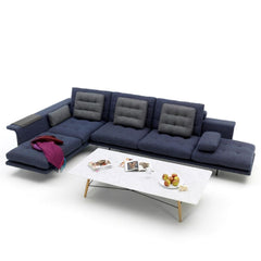 Vitra Antonio Citterio Grand Sofá in Midnight Blue in Situ with Color Block Blanket and Coffee Table