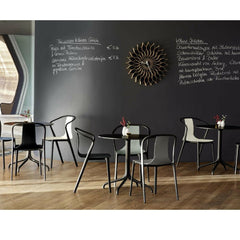Vitra Bouroullec Belleville Chairs in Cafe with Nelson Sunflower Clock