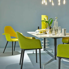 Eames Saarinen Organic Chair in Bright Yellow in room with Bouroullec Softshell Dining Chairs Salone di Mobile