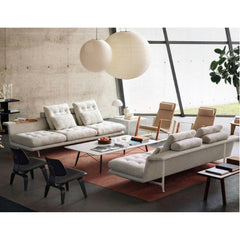 Vitra Antonio Citterio Grand Sofas in room with Prouve Cite Chairs and Eames Chairs