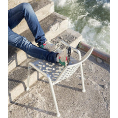 Vitra Landi Chair by Hans Coray outdoors with feet kicked up relaxing