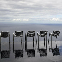 Vitra Landi Chairs by Hans Coray at water's edge