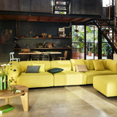 Vitra Prouve Gueridon Bas Coffee Table in room with yellow Jasper Morrison Soft Modular Sofa
