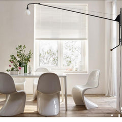Vitra Prouvé Potence Lamp in room with Panton Classic Chairs
