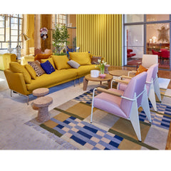 Vitra Suita Sofa by Antonio Citterio in room with Prouve Fauteuil Direction Chairs