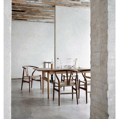 Walnut Wegner Wishbone Chairs in Rustic Room