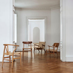 Hans Wegner CH25 CH24 and CH23 chairs in room