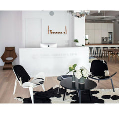 Wegner CH008 Coffee Table in Black with Black and White Cowhide Shell Chairs in Carl Hansen Showroom
