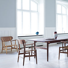 Wegner CH22 Lounge Chair in Room with CH27 Dining Chairs and Table by Carl Hansen and Son