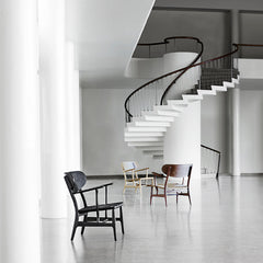 Wegner CH22 Chairs in Room with Staircase Carl Hansen and Son