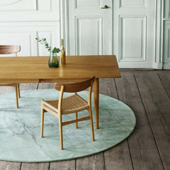 Wegner CH23 Oak Dining Chairs in Room with Dining Table and Naja Utzon Popov Circle Rug Carl Hansen and Son