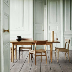 Wegner CH23 Oak and Walnut Chairs in Room with Dining Table Hansen and Son