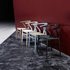 Wegner Wishbone Chairs in Room with Burgandy Wall Carl Hansen and Son