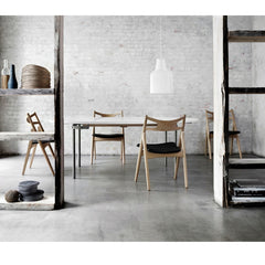 Wegner Sawbuck Chair CH29 in room Carl Hansen & Son