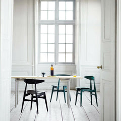 Wegner CH33 dining chairs in room with dining table Carl Hansen and Son
