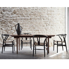 Wegner C338 Dining Table Walnut in room with Wishbone Chairs Carl Hansen and Son