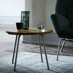 Hans Wegner CH415 Side Table in room with Oculus Chair Carl Hansen and Son