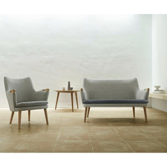 Hans Wegner CH71 Lounge Chair in room with CH72 Sofa in Kvadrat Divina Melange Carl Hansen and Son