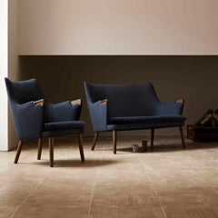 Wegner CH72 Sofa and CH71 Chair in Walnut with Dark Blue Canvas Styled in Room Carl Hansen and Son