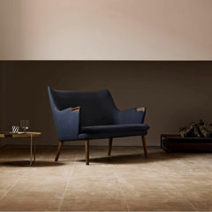Wegner CH72 Sofa Dark Blue with Walnut Base styled in room