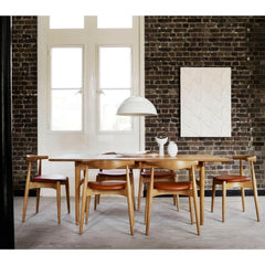 Hans Wegner Elbow Chairs in Loft Dining Room with Wegner Dining Table