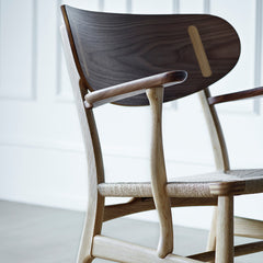 Wegner CH22 Lounge Chair in Walnut and Oak Closeup by Carl Hansen and Son
