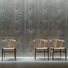 Wegner Wishbone Chairs in Arken with Concrete Walls