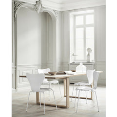 White Monochrome Series 7 Chairs in Room with Cecile Manz Table Arne Jacobsen Fritz Hansen