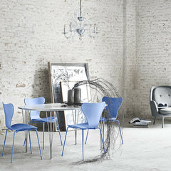 Fritz Hansen Super Elliptical Table in Room with Monochrome Trieste Blue Series 7 Chairs